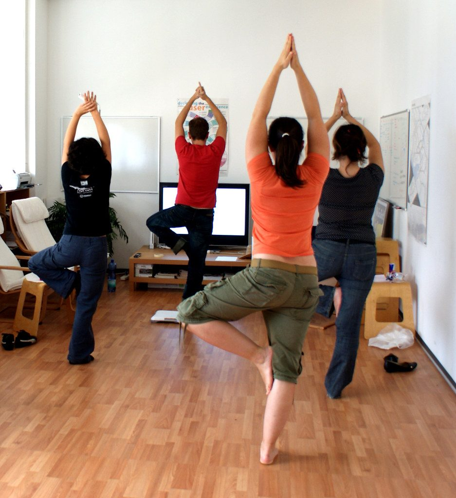 Office yoga sessions for employee fitness